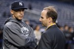 Manager Joe Girardi (L) and General Manager Brian Cashman of the New York Yankees look on during batting practice against the Philadelphia Phillies in Game One of the 2009 MLB World Series at Yankee Stadium on October 28, 2009 in the Bronx borough of New York City. Al Bello / Getty Images North America ..........