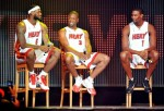 LeBron James (6), Dwyane Wade (3) and Chris Bosh (1) of the Miami Heat speak after being introduced to fans during a welcome party at American Airlines Arena on July 9, 2010 in Miami, Florida. Photo by Doug Benc/Getty Images ........