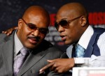 CEO of Mayweather Promotions Leonard Ellerbe (L) talks with boxer Floyd Mayweather Jr. during the final news conference for Mayweather's bout against Shane Mosley at the MGM Grand Hotel/Casino April 28, 2010 in Las Vegas, Nevada. Mayweather and Mosley will meet in a 12-round welterweight bout on May 1, 2010 in Las Vegas. Getty Images / Ethan Miller ......