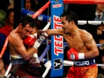 Pacquiao (left) seen here on the offensive against Oscar de La Hoya in their lt welterweight bout at the MGM Grand , Las Vegas , Nevada. Pacquiao would go on to defeat de La Hoya with an eight stoppage in their bout which took place on 6th December 2008. AFP/ Getty Images/ Martin Vazquez ..........
