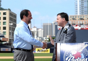 Padres Chairman John Moores (right) and the team's new Vice Chairman/CEO Jeff Moorad shook hands at home plate at PETCO Park at midafternoon Thursday. And with that, a new era in Padres baseball began. Moorad became a senior partner in the ownership syndicate of the Padres April of 2009. Associated Press/ Chris Thompson .......