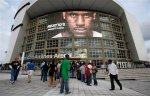 A portrait of Miami Heat forward LeBron James is shown on a screen as fans wait outside American Airlines Arena for the doors to open, before a preseason NBA basketball game between the Heat and the Detroit Pistons in Miami, Tuesday, Oct. 5, 2010. AP Photo/Lynne Sladky ....