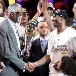 Bill Russell presents the Bill Russell Finals MVP trophy to Kobe Bryant after the Lakers defeated the Celtics in Game 7. Inset also is ABC/ ESPN sports presenter Stuart Scott. Getty Images /Christian Petersen .........