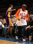 Director Spike Lee jumps out of his seat to avoid a collision with Trevor Ariza #3 during the game between the Los Angeles Lakers and the New York Knicks on February 2, 2009 at Madison Square Garden in New York City . Getty Images/ Nick Laham .........